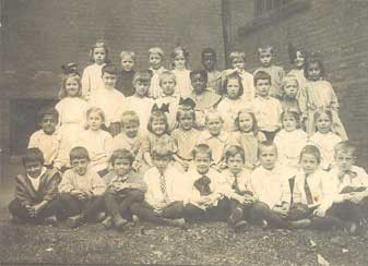 Bertha as a child with lots of other children
